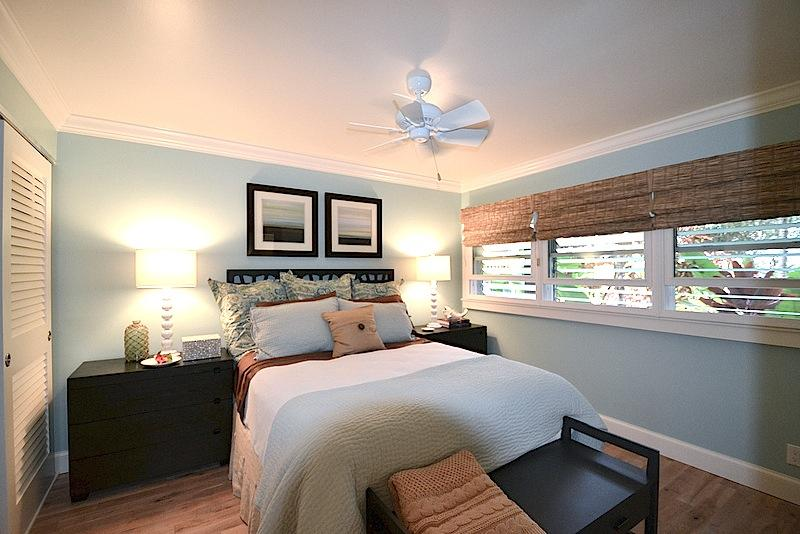 Bedroom with soothing colors, pillow top bed, AC, fan